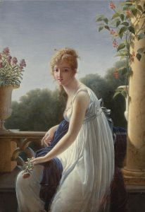 A YOUNG WOMAN SEATED BY A WINDOW